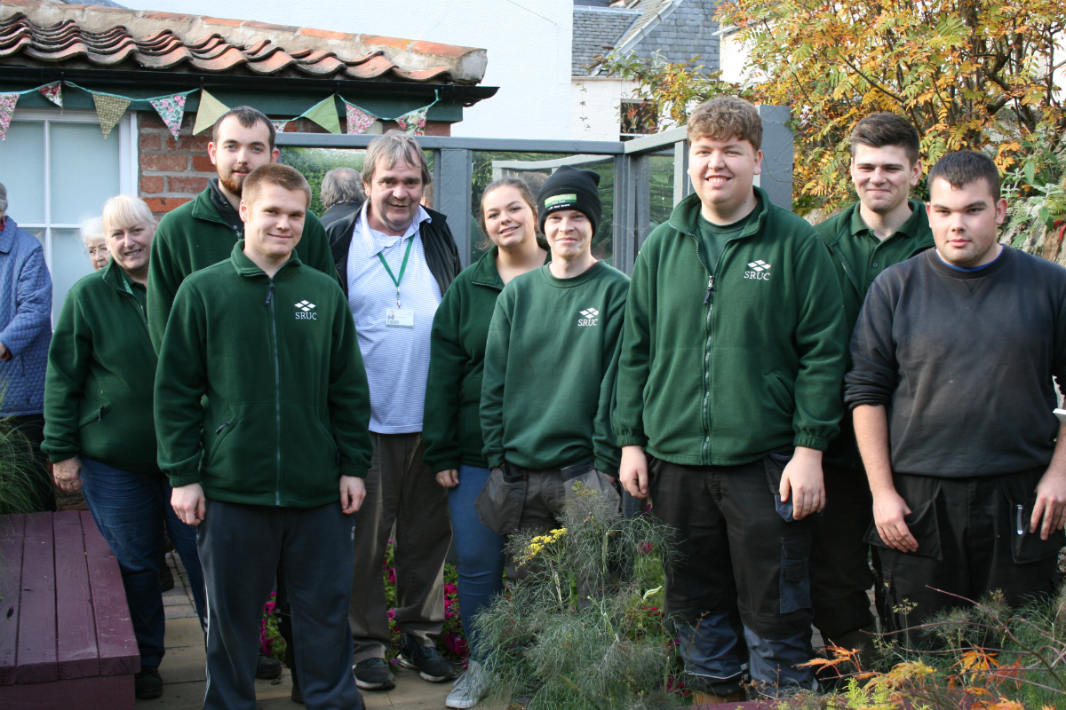 Lecturer Bruce Robertson with some of the students involved in the project