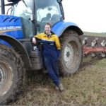 Erica next to tractor